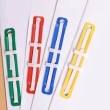 1 caja clip de encuadernacion de metal con dos orificios