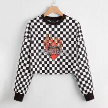 Pullover mit Feuer & Buchstaben Muster, sehr tief angesetzter Schulterpartie und Karo Muster