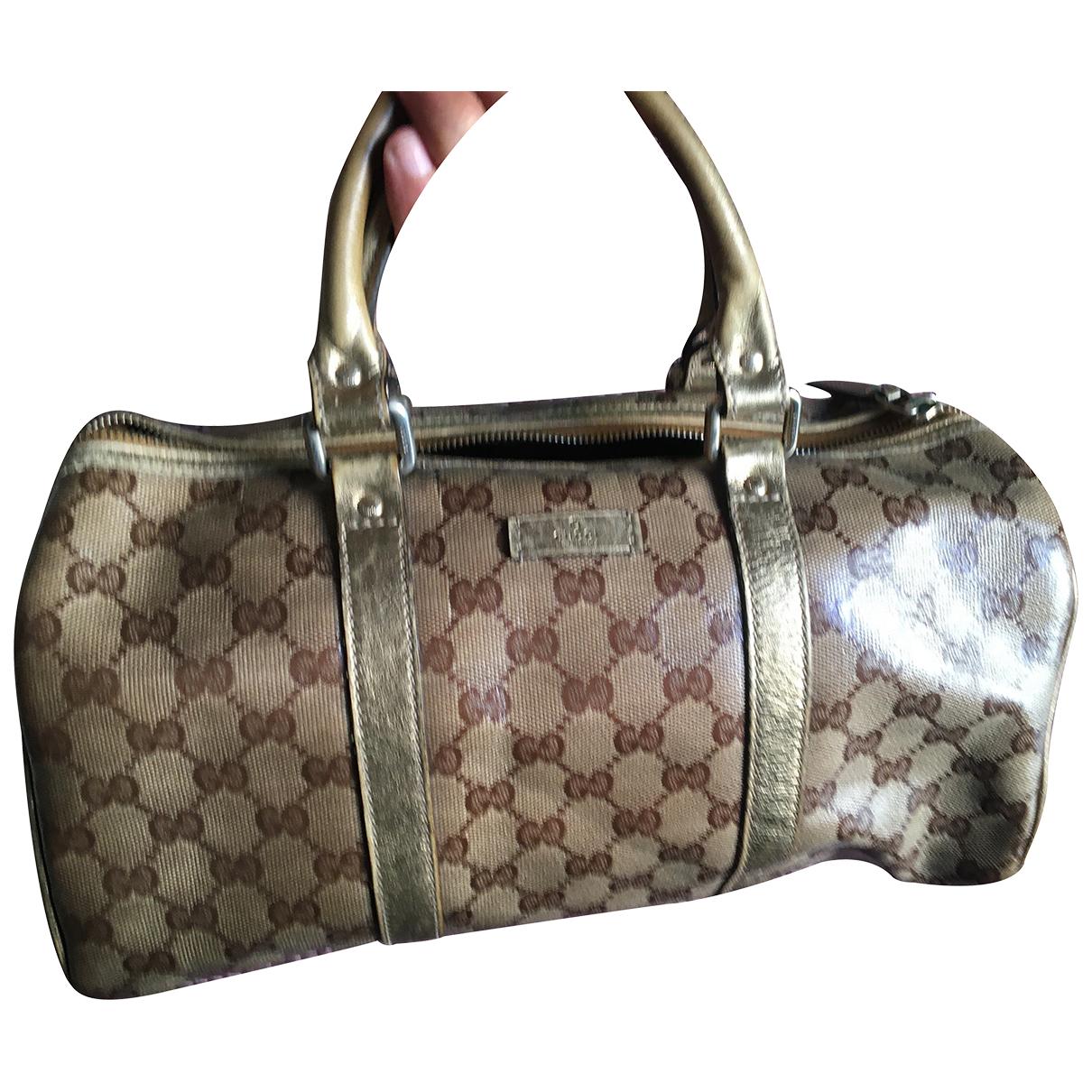 Gucci N Gold Cloth handbag for Women N