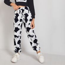 Pantalones con estampado de vaca con bolsillo oblicuo