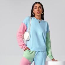 Pullover de color combinado de hombros caidos