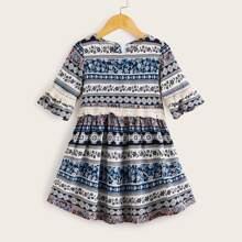 Vestido linea A de niñitas ribete con fleco con estampado azteca