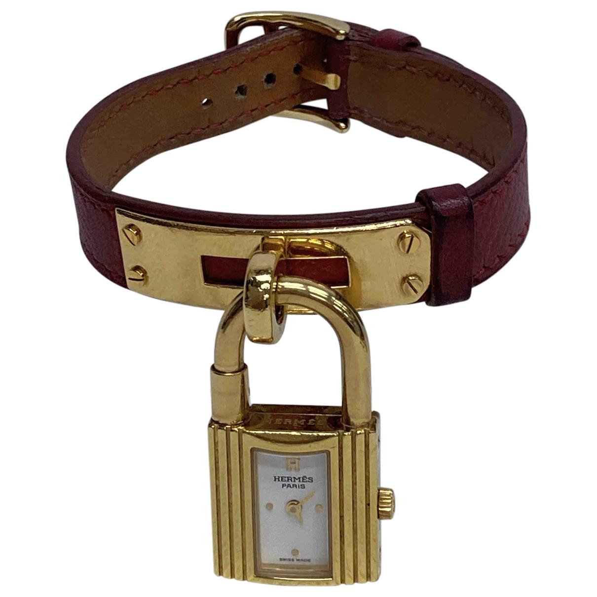 Hermes - Montre Kelly pour femme en plaque or - dore