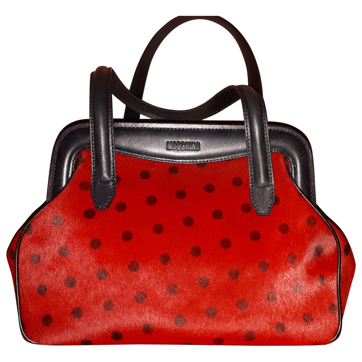 Moschino \N Handtasche in  Rot Kalbsleder in Pony-Optik