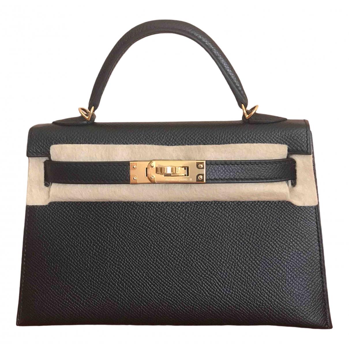 Hermes Kelly Mini Handtasche in  Schwarz Leder