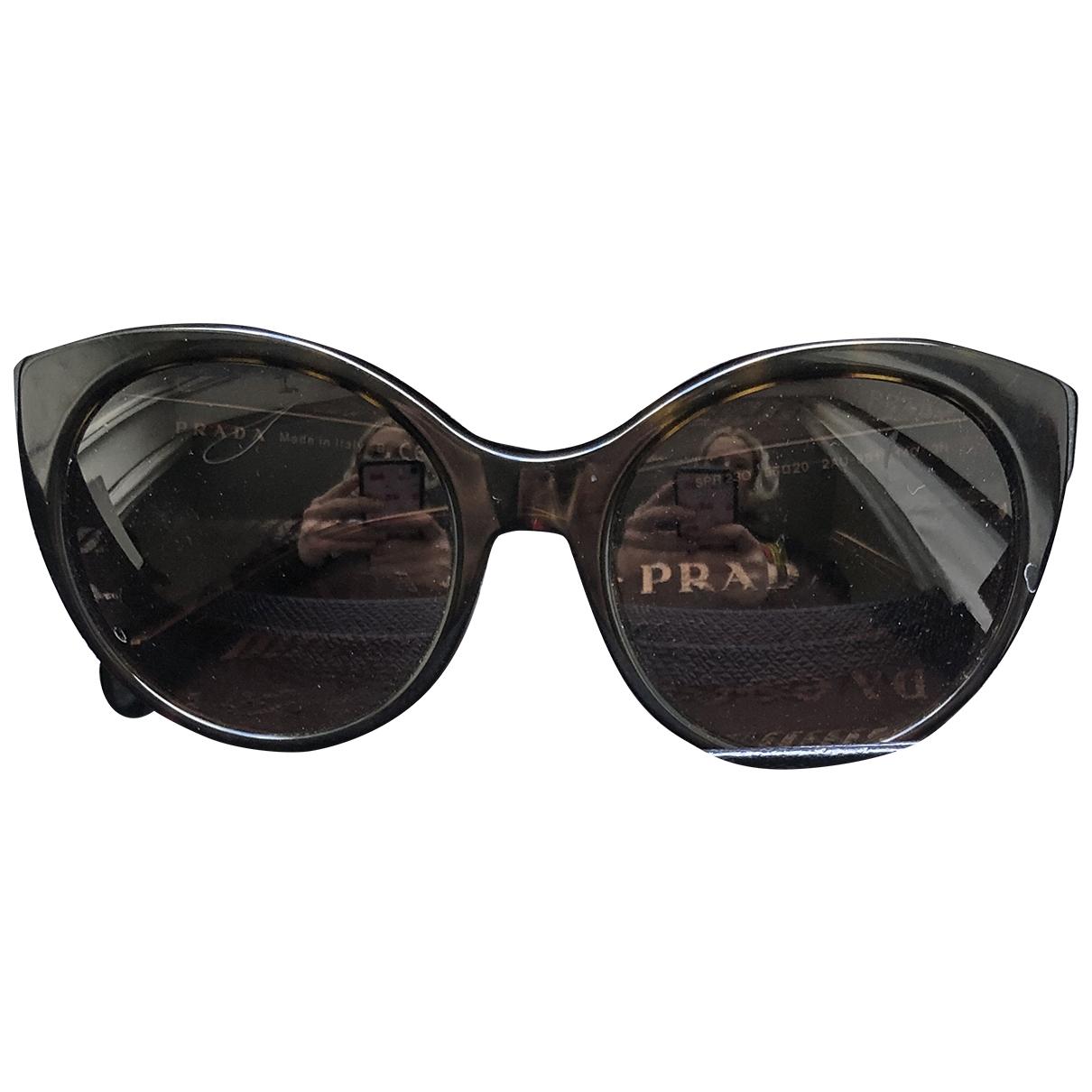 Prada \N Sonnenbrillen in  Braun Kunststoff