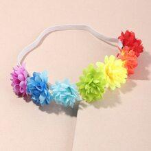 Diadema de niñitas con diseño de flor