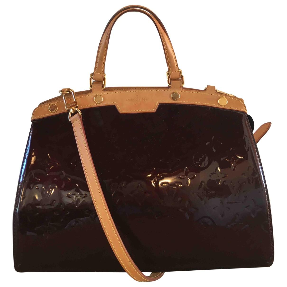 Louis Vuitton - Sac a main Brea pour femme en cuir verni - bordeaux