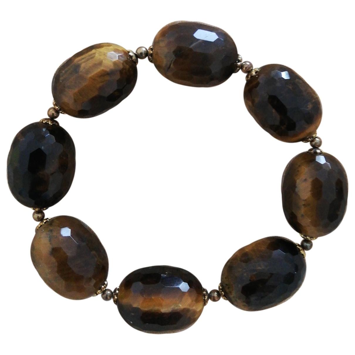 - Bracelet   pour femme en metal - marron