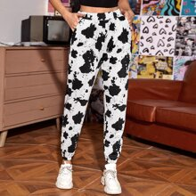 Pantalones deportivos con bolsillo oblicuo con patron de vaca