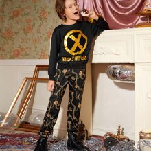 Conjunto pullover con estampado de slogan y dibujo con pantalones deportivos con cadena