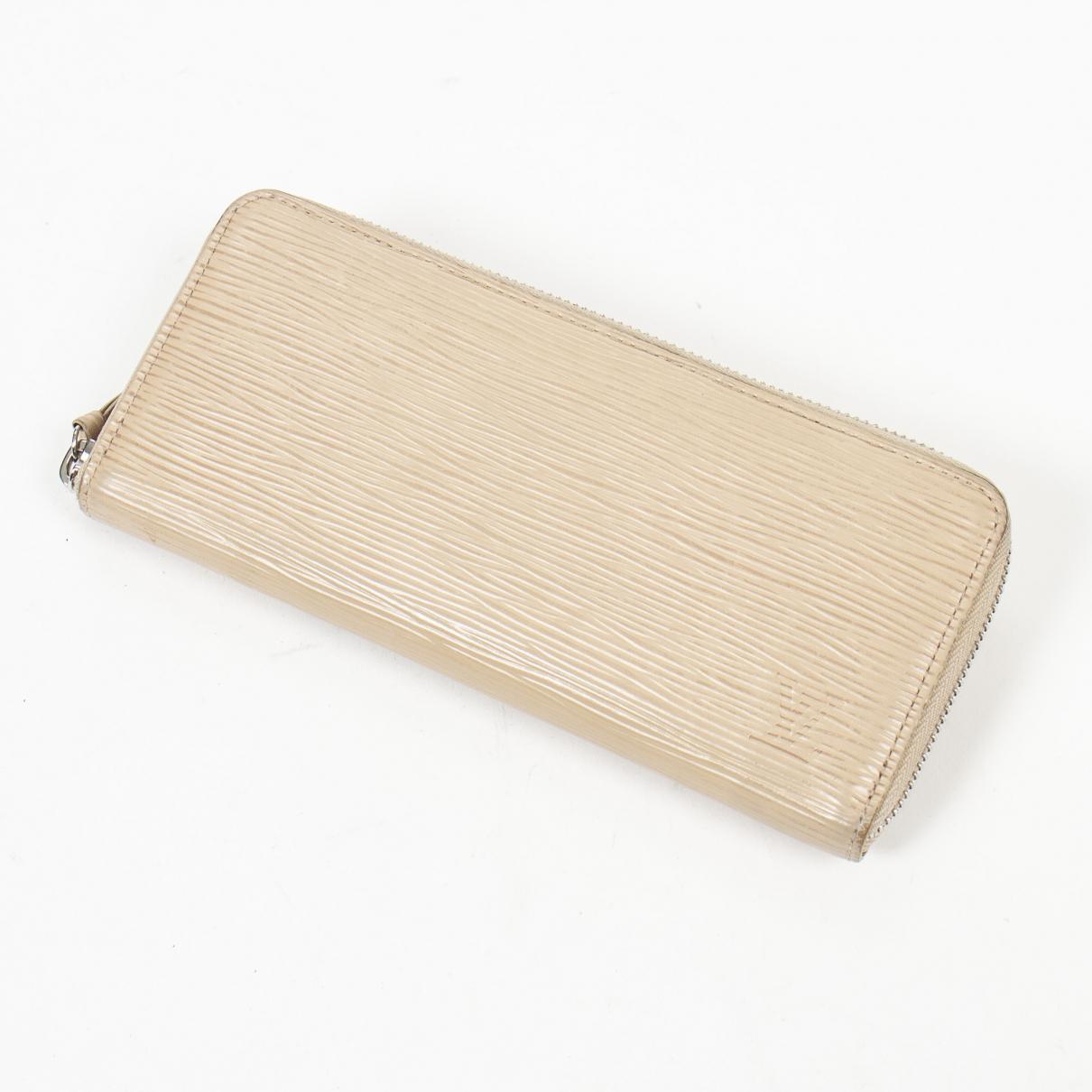 Louis Vuitton - Portefeuille Clemence pour femme en cuir - beige