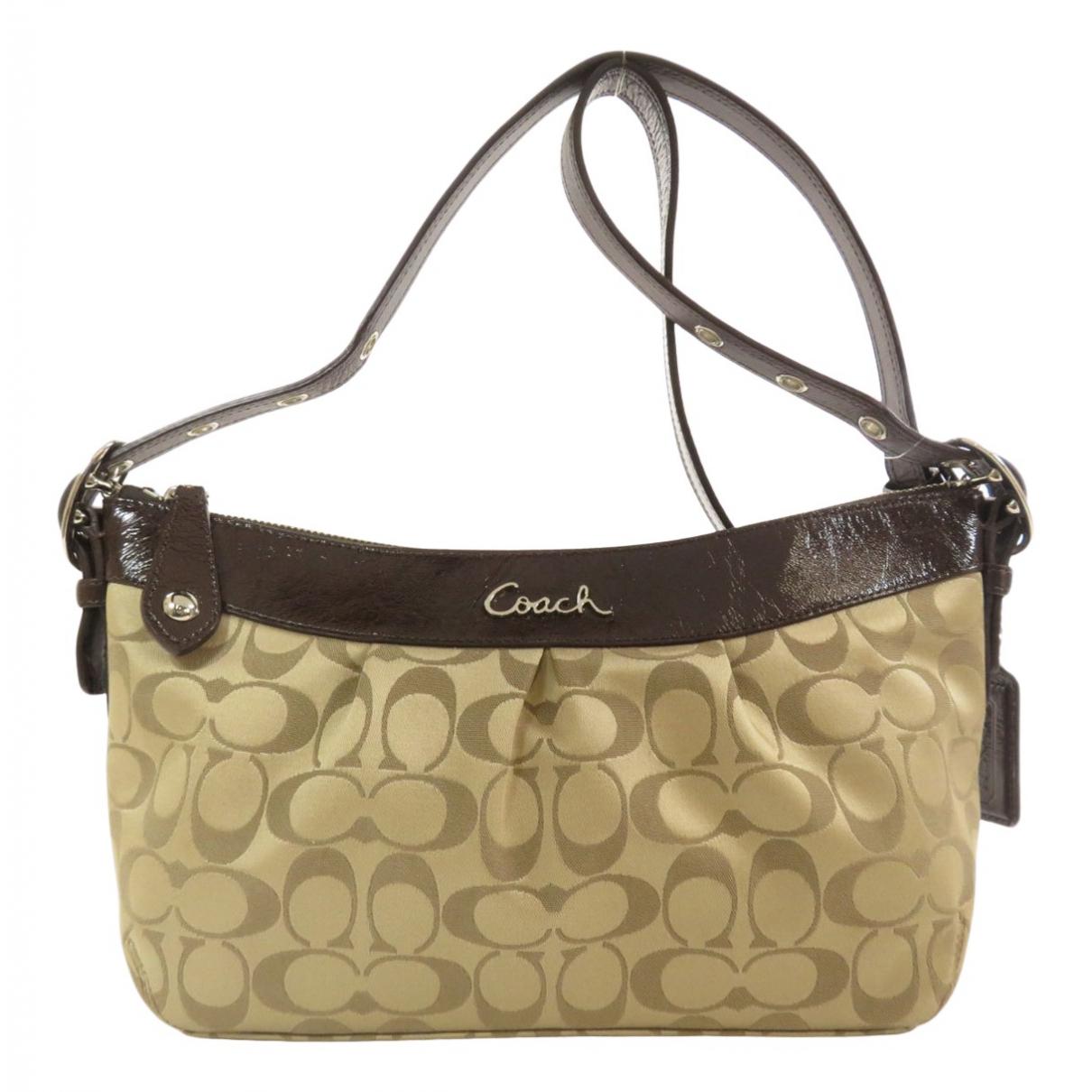 Coach \N Beige Cloth Clutch bag for Women \N