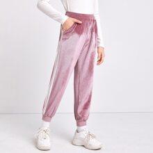 Pantalones de terciopelo tejidos de canale con bolsillo oblicuo de lado de rayas en contraste