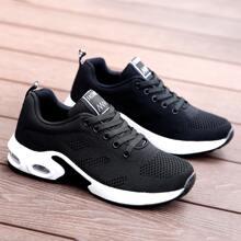 Zapatillas deportivas tejidas anchas con cordon delantero
