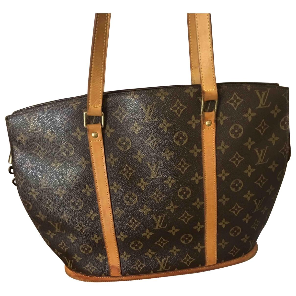 Louis Vuitton Babylone vintage Handtasche in  Braun Leinen