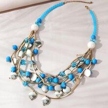 Mehrschichtige Halskette mit rundem Dekor
