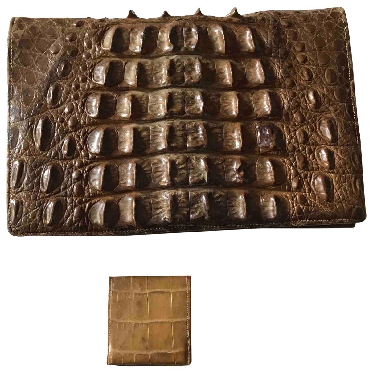 - Pochette   pour femme en crocodile - marron