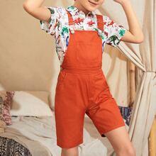 Shorts overol de niños con bolsillo delantero con tiras ajustables con tiras cruzadas
