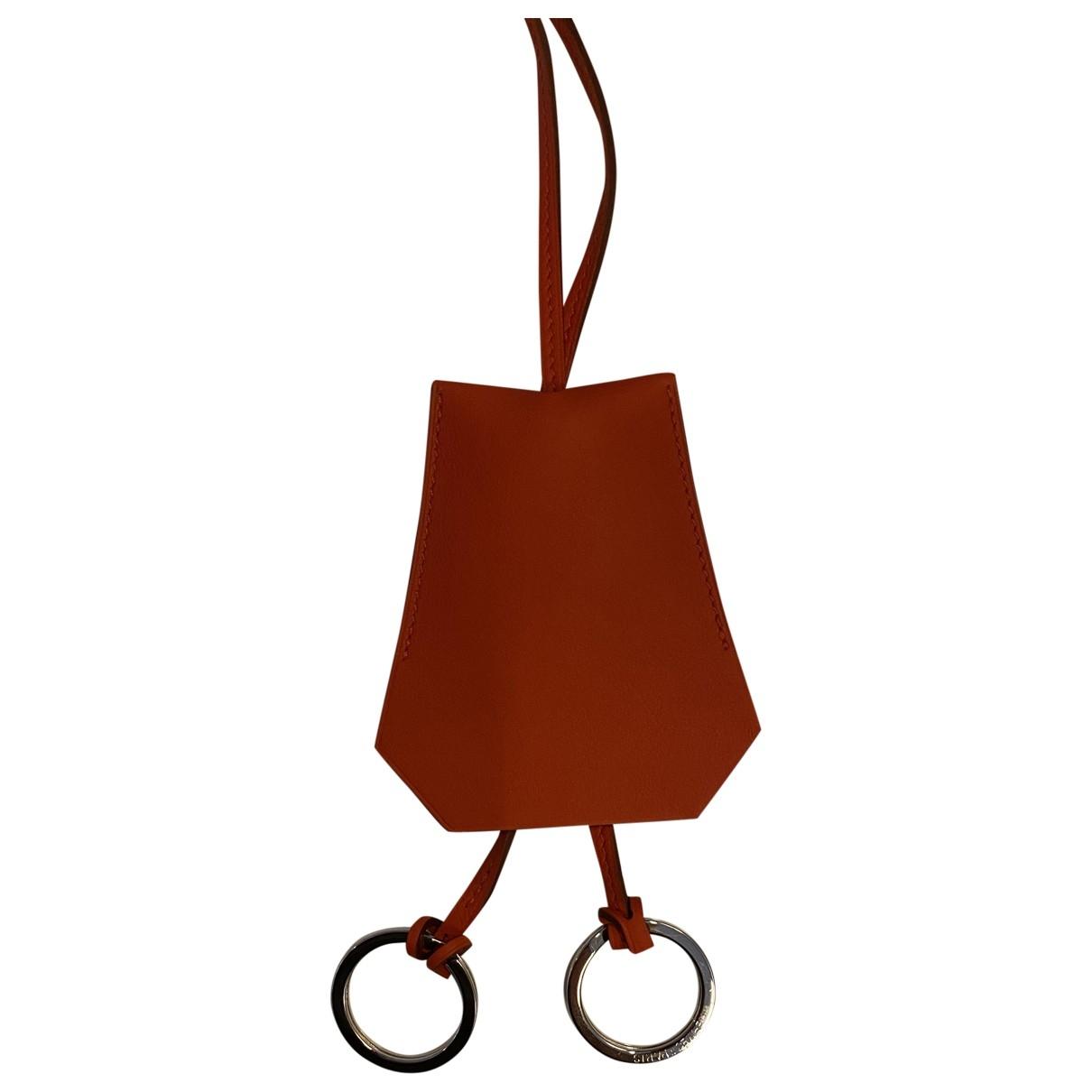 Hermes \N Taschenschmuck in  Orange Leder