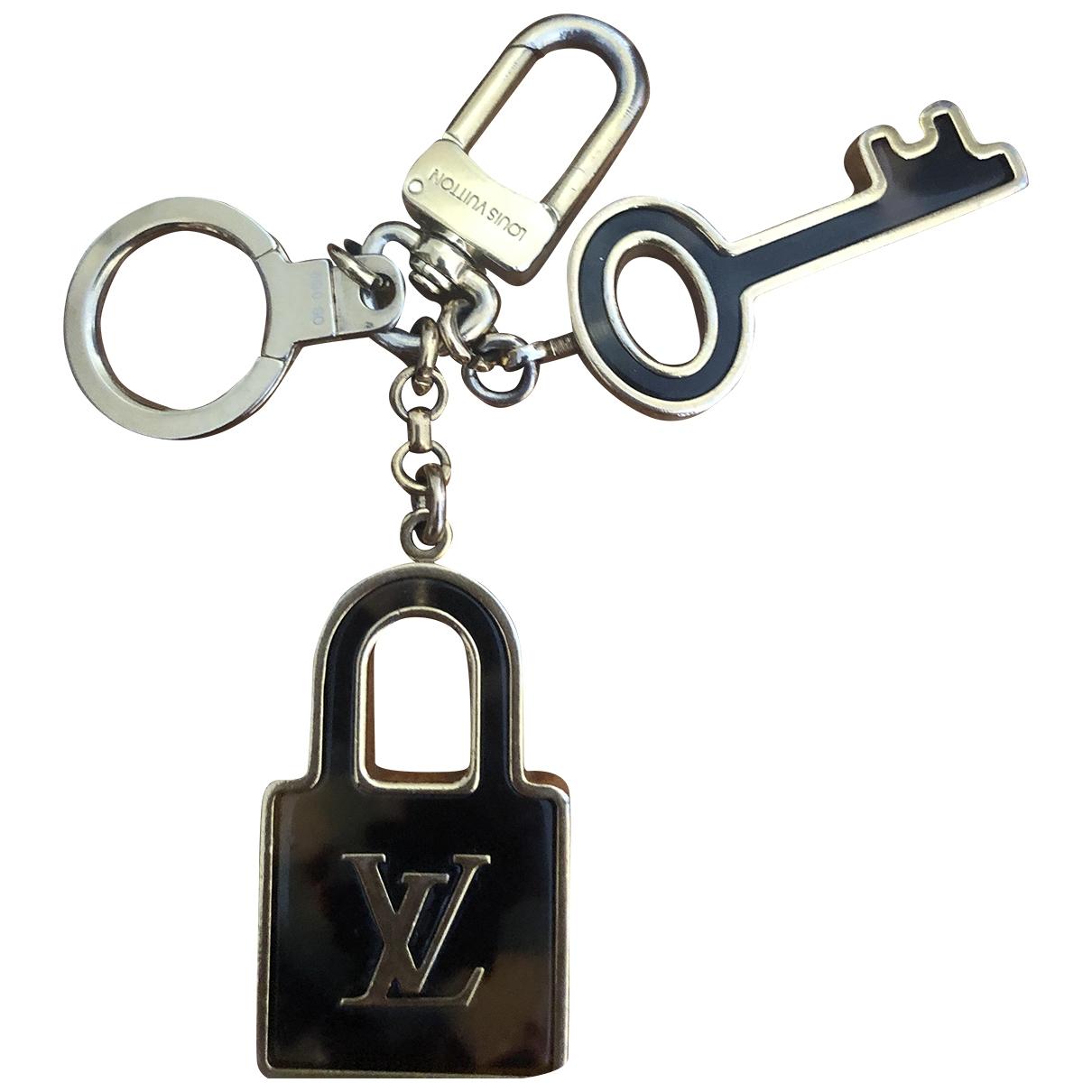 Louis Vuitton \N Taschenschmuck in  Braun Metall