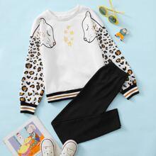 Conjunto pullover ribete de rayas con estampado de estrella de leopardo con leggings