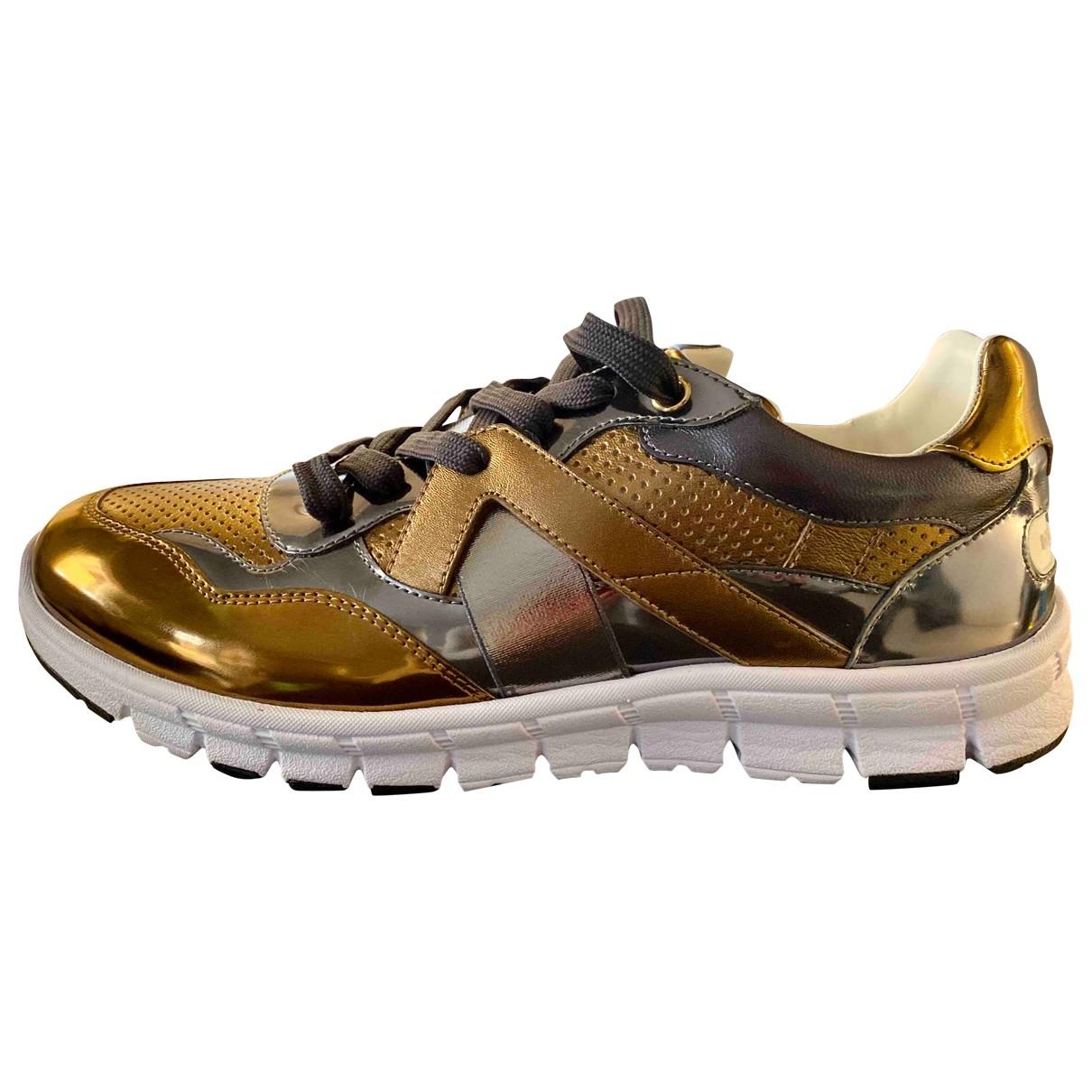 Dolce & Gabbana - Baskets   pour homme en cuir - dore