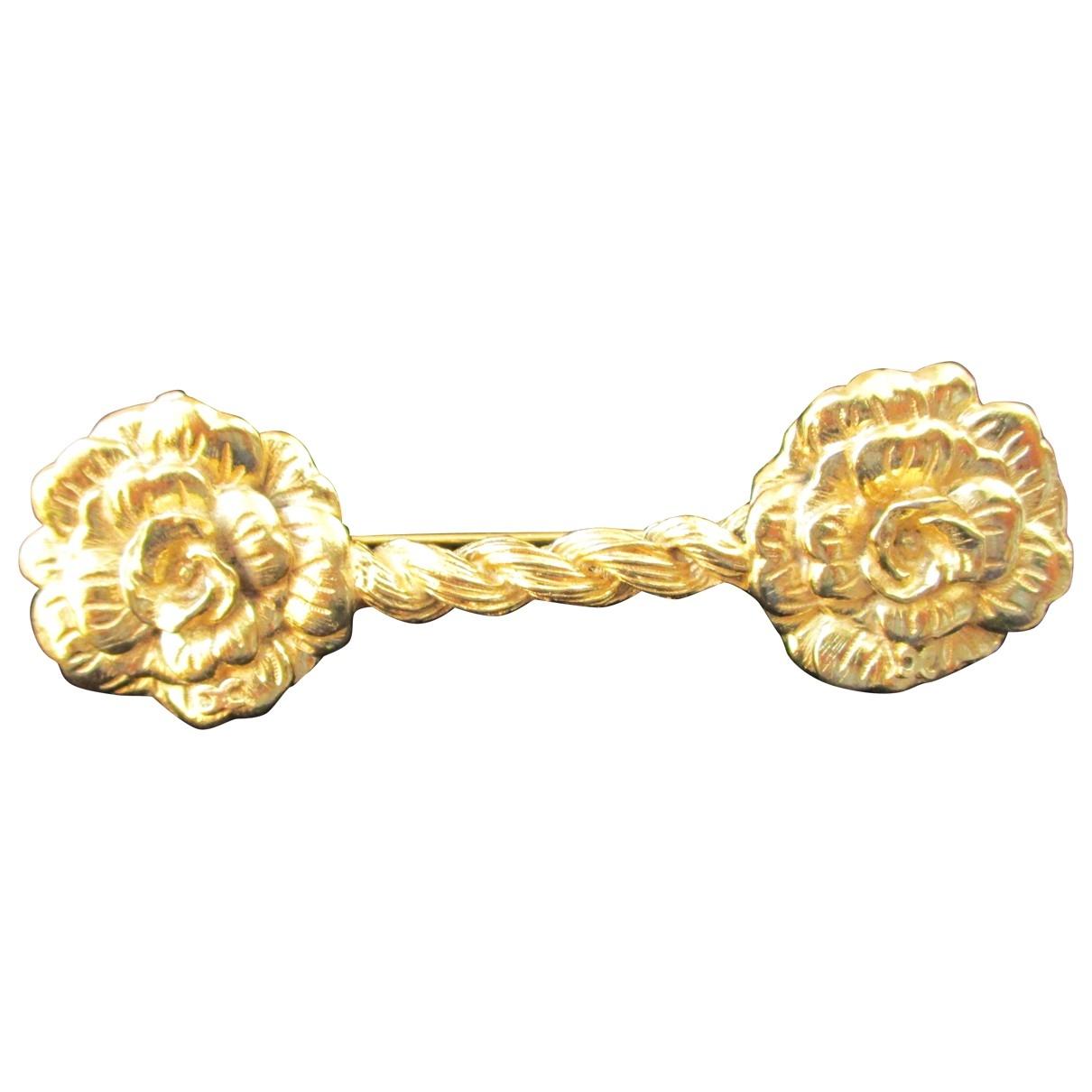 Broche Camelia en Metal Dorado Chanel