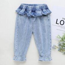 Jeans mit Ruesche und Taschen
