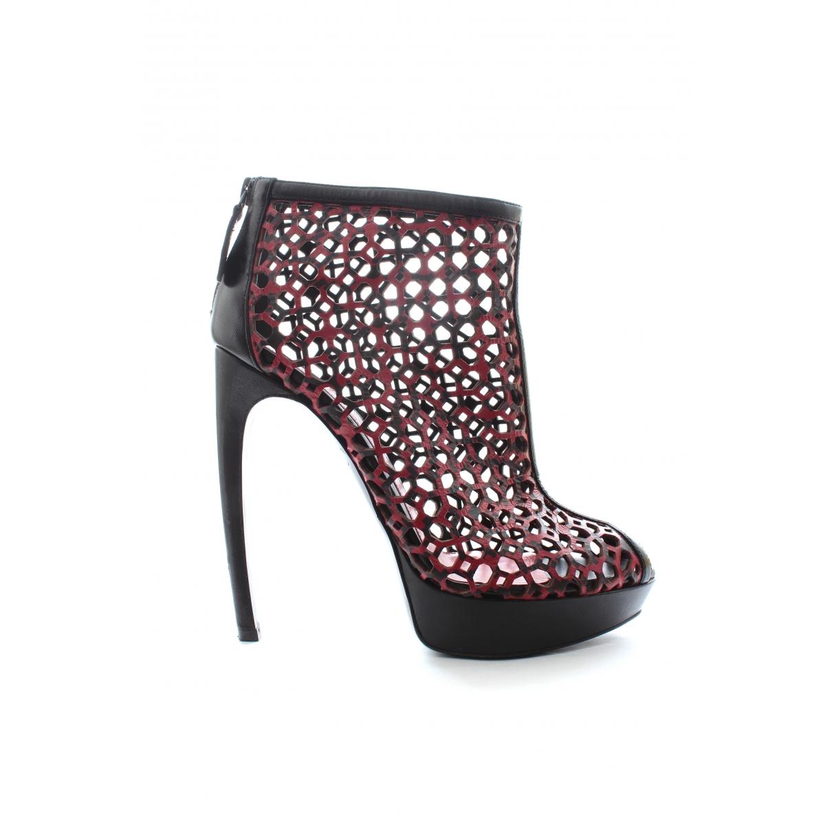 Alexander Mcqueen - Boots   pour femme en cuir - rouge