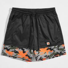 Shorts 2 en 1 de camuflaje