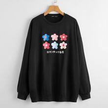 Sudadera de hombros caidos con estampado floral con letra japonesa