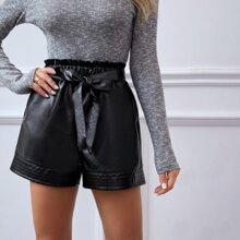 Shorts PU con bolsillo de cintura con volante