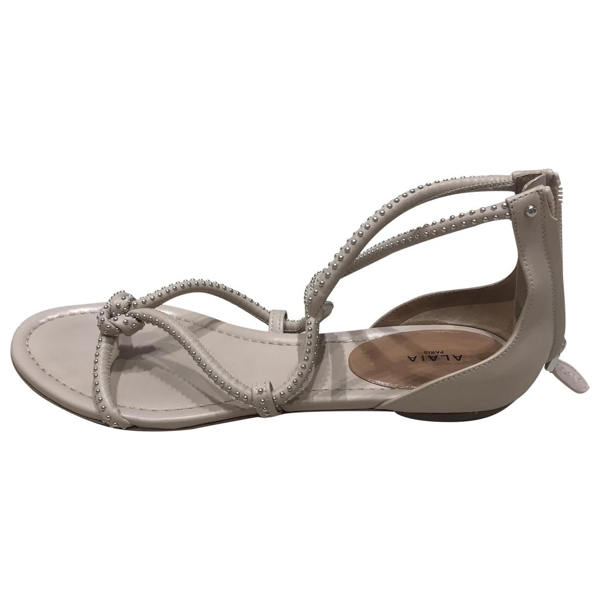 Alaia - Sandales   pour femme en cuir - beige