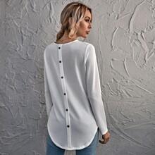Camiseta bajo curvo con boton