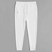 Pantalones deportivos con parche de cintura con cordon