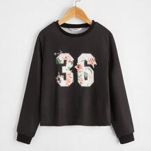 Pullover con estampado floral con numero