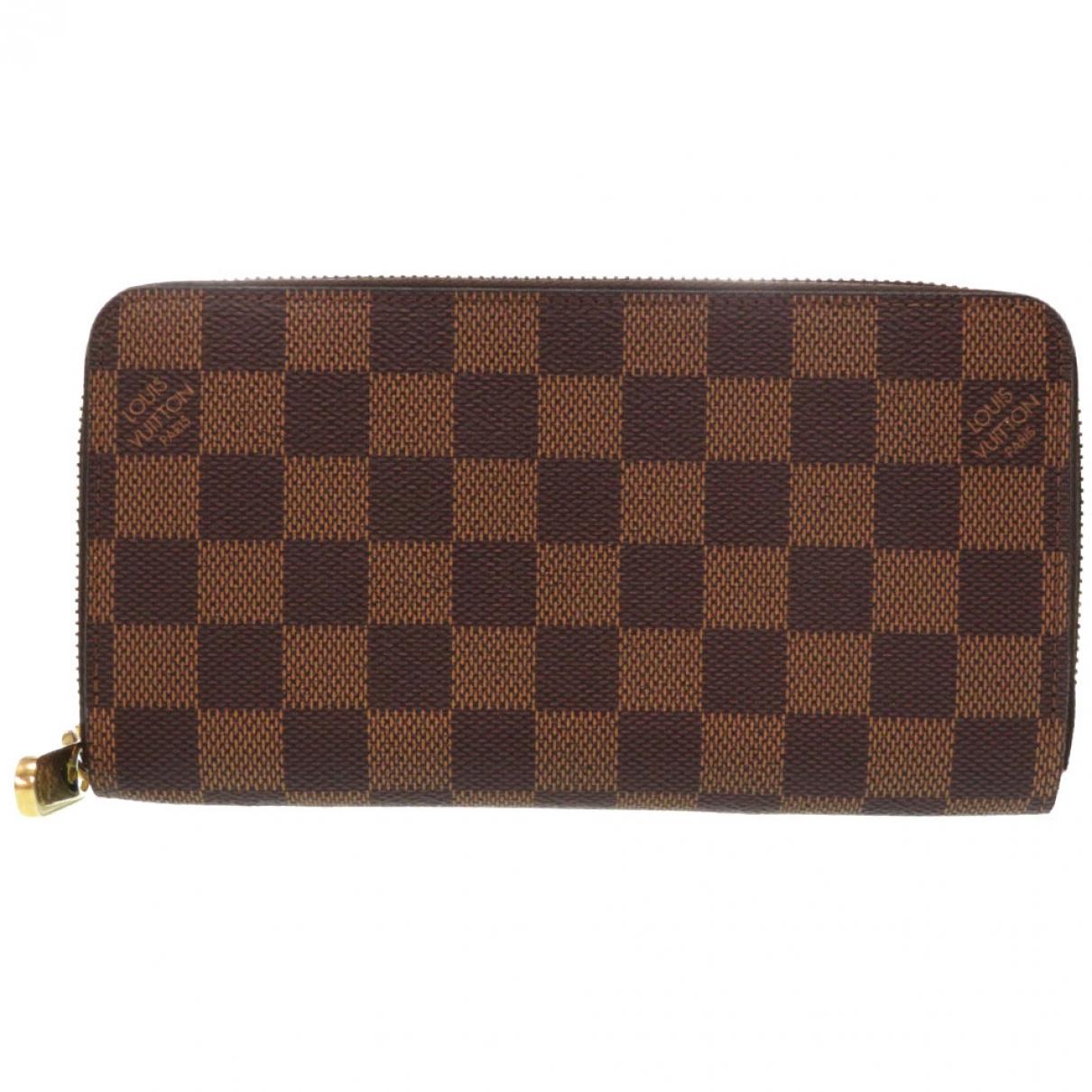 Louis Vuitton - Portefeuille Zippy pour femme en toile - marron