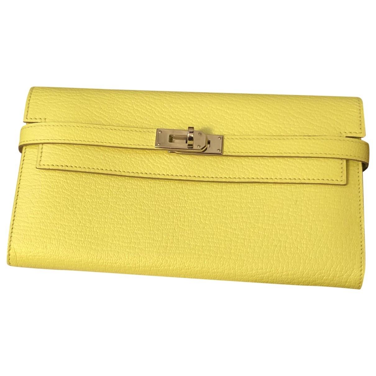 Hermes Kelly Portemonnaie in  Gelb Leder