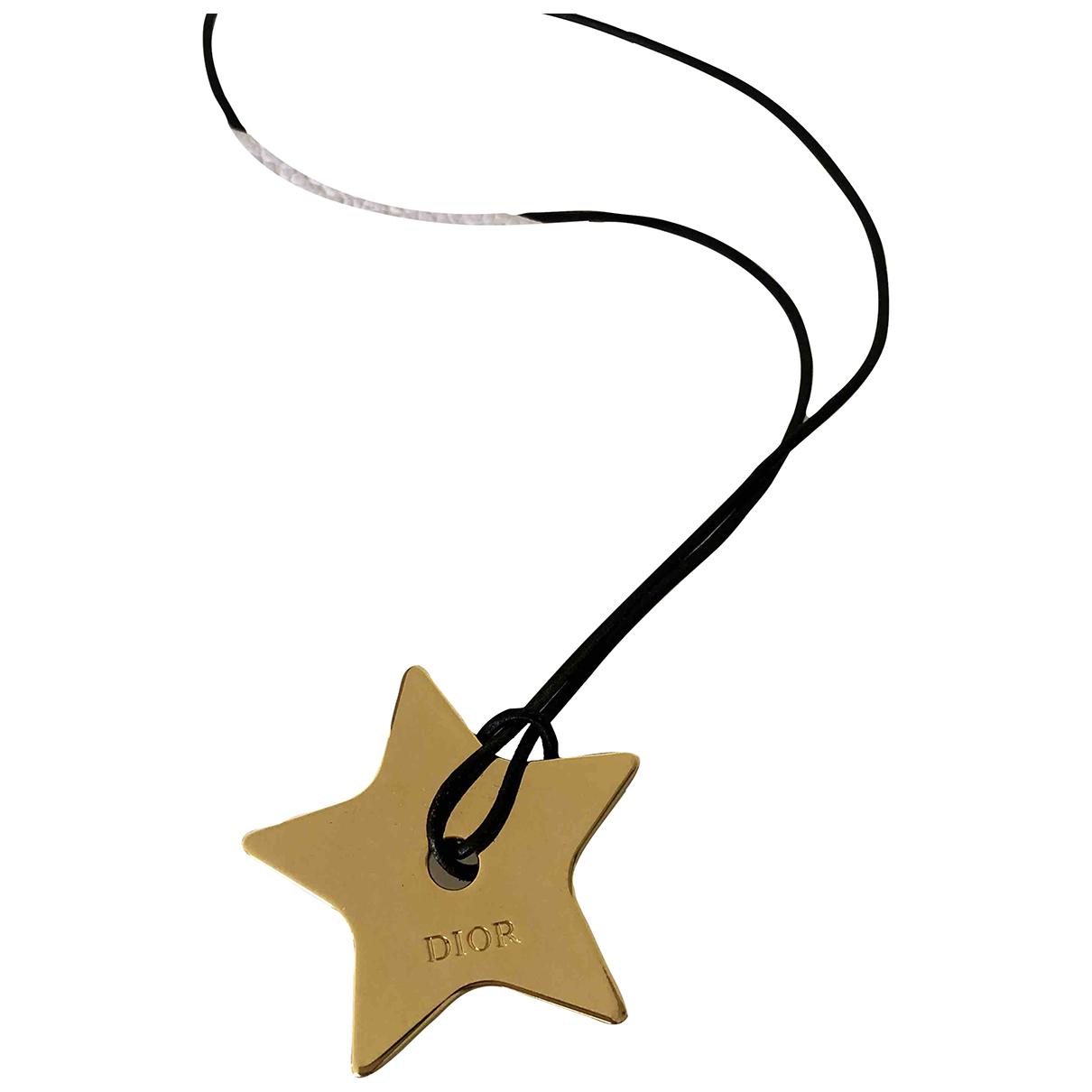 Dior - Pendentif   pour femme en metal - dore