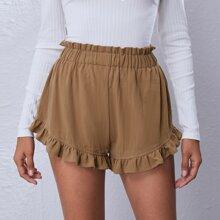 Shorts mit Papiertasche um die Taille und Rueschenbesatz