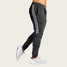 Pantalones deportivos de hombres de cintura con cordon de lado de rayas