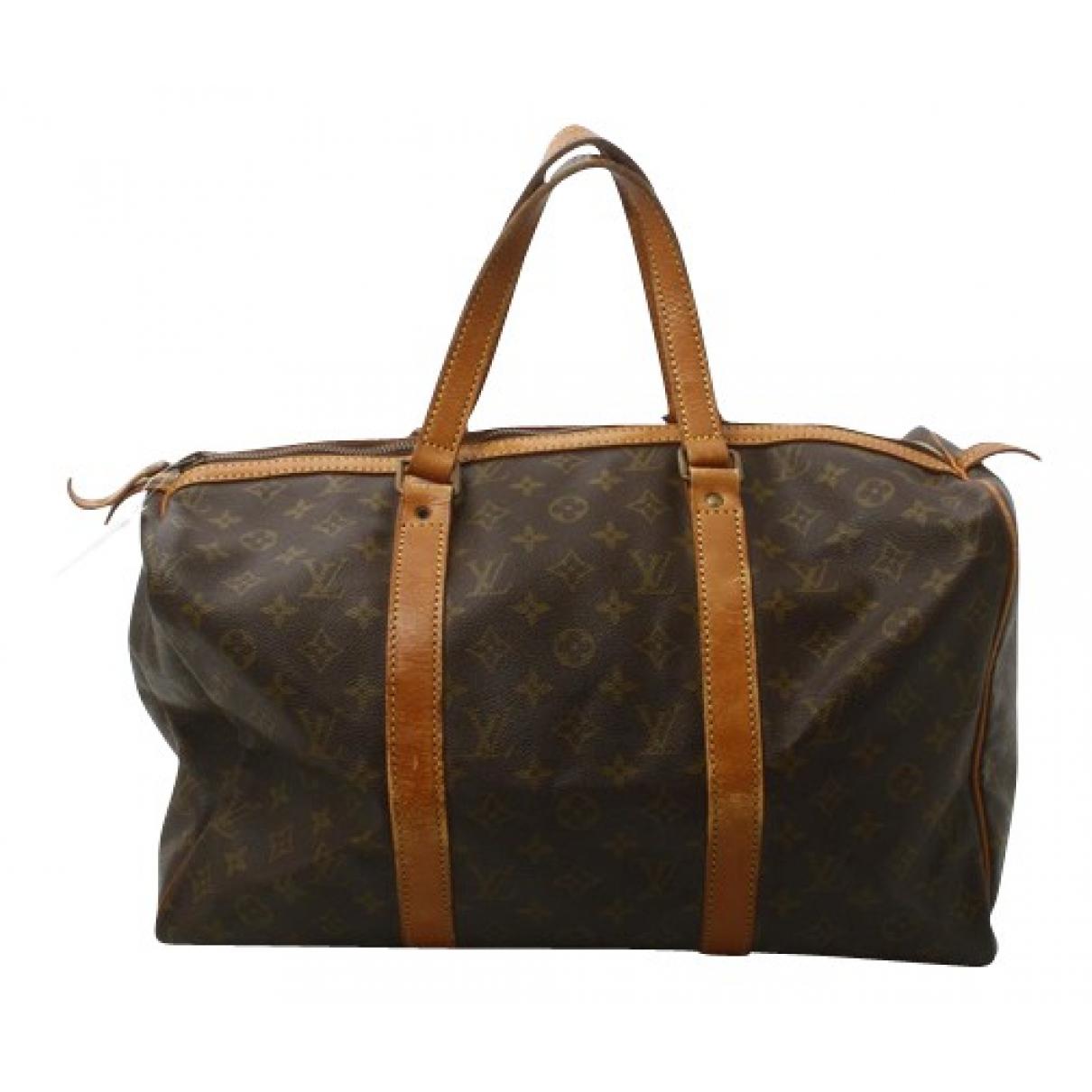 Louis Vuitton - Sac de voyage Sac souple  pour femme en toile - marron