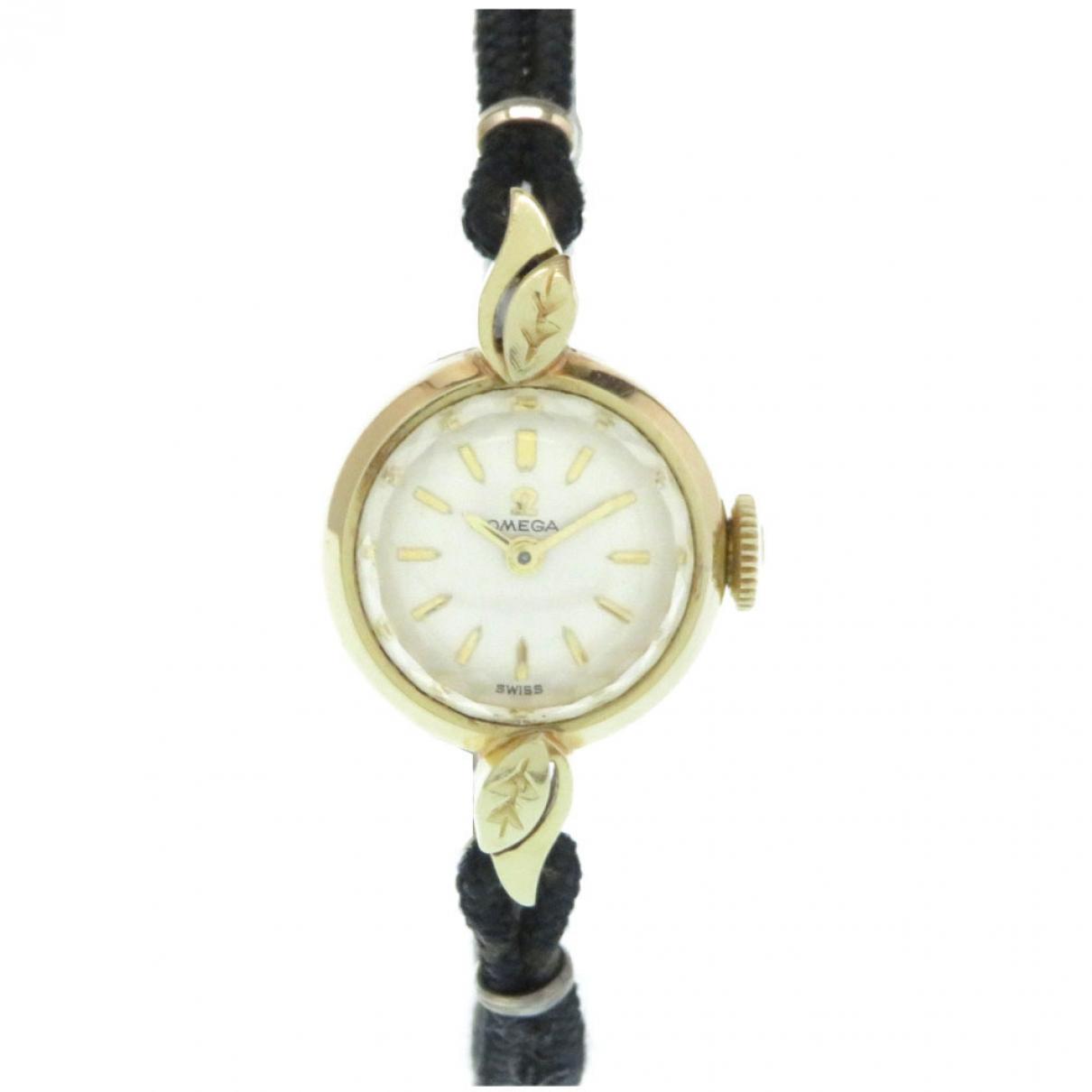 Omega \N Uhr in  Gold Gelbgold