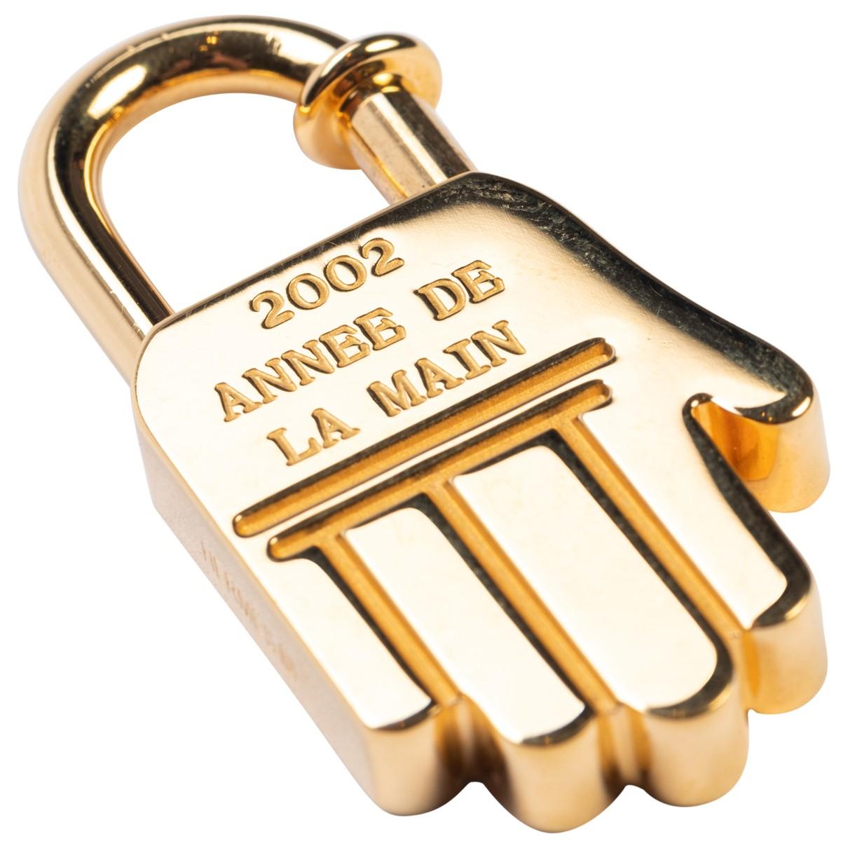Hermès \N Gold Metal Bag charms for Women \N