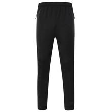 Pantalones deportivos con cremallera lateral