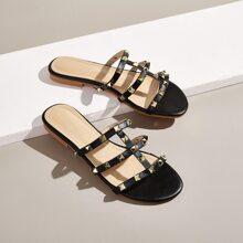 Zapatillas de punta abierta con diseño de tachuela