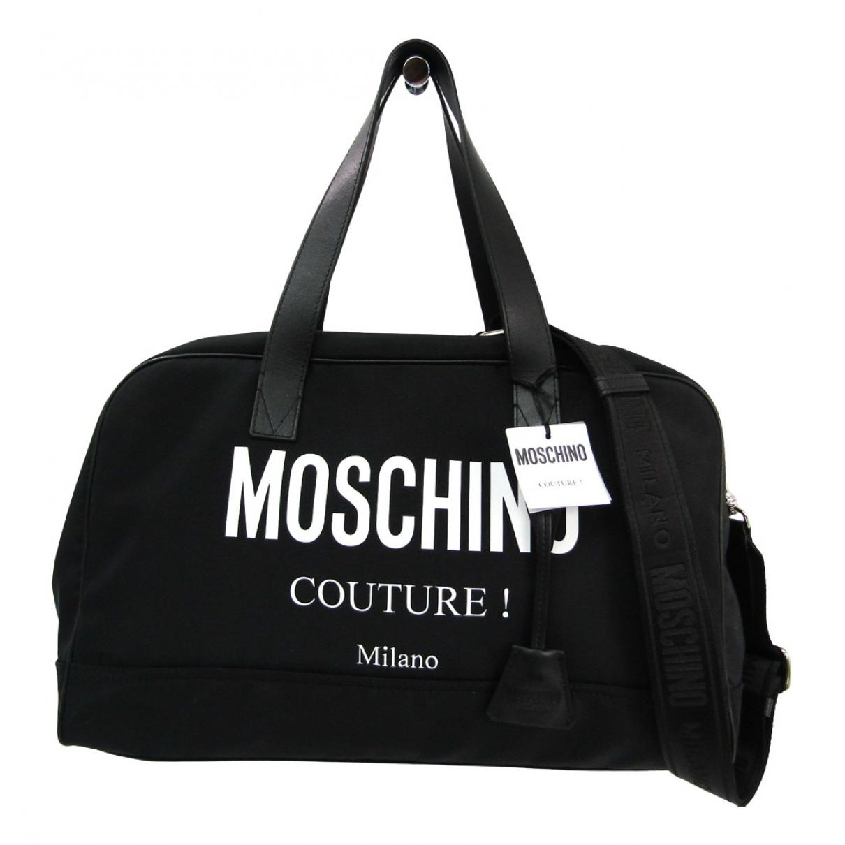 Moschino - Sac de voyage   pour femme en toile - noir
