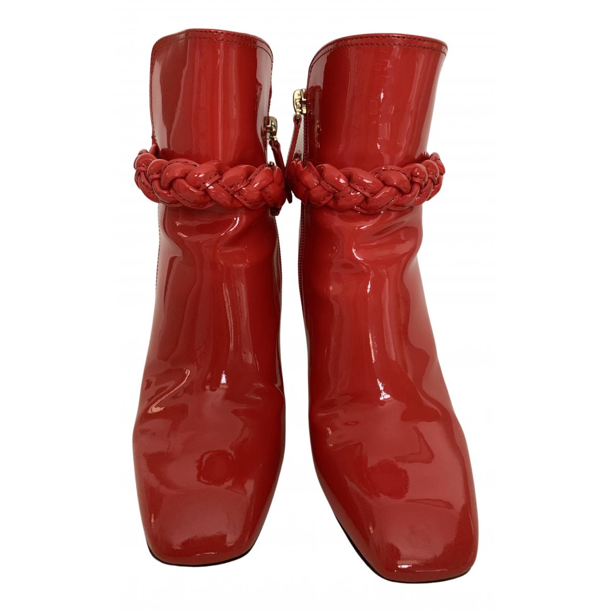 Valentino Garavani - Boots   pour femme en cuir verni - rouge