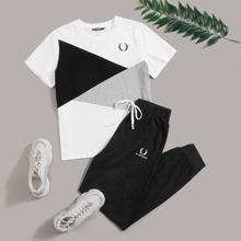 Conjunto top de color combinado con estampado de dibujo con pantalones deportivos